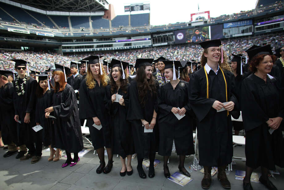 Graduates are asked to stand. Photo: JOSHUA TRUJILLO, SEATTLEPI.COM / SEATTLEPI.COM