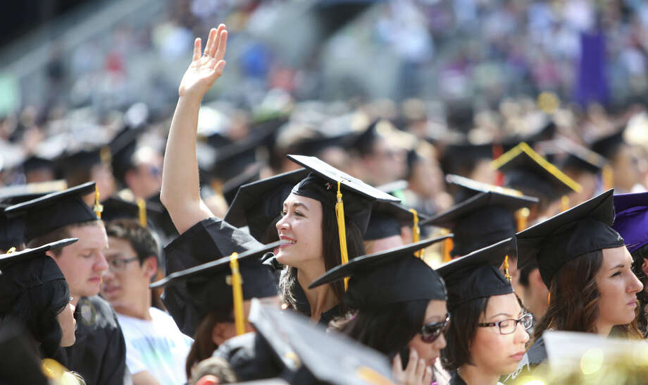 A graduate waves. Photo: JOSHUA TRUJILLO, SEATTLEPI.COM / SEATTLEPI.COM