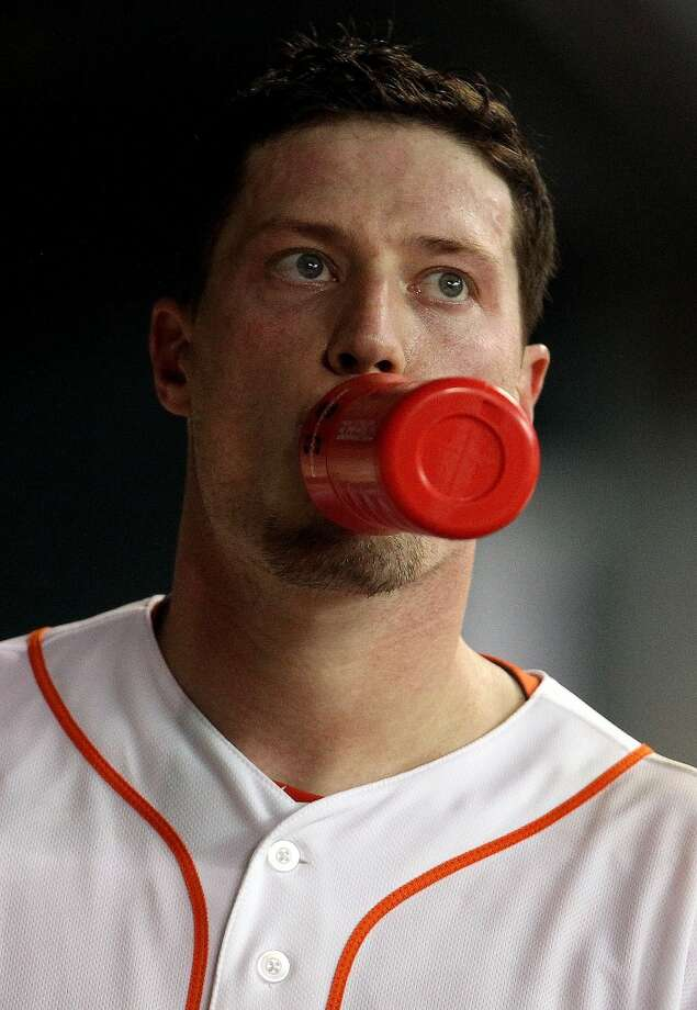 Astros starting pitcher Lucas Harrell reacts in the dugout after being pulled.
