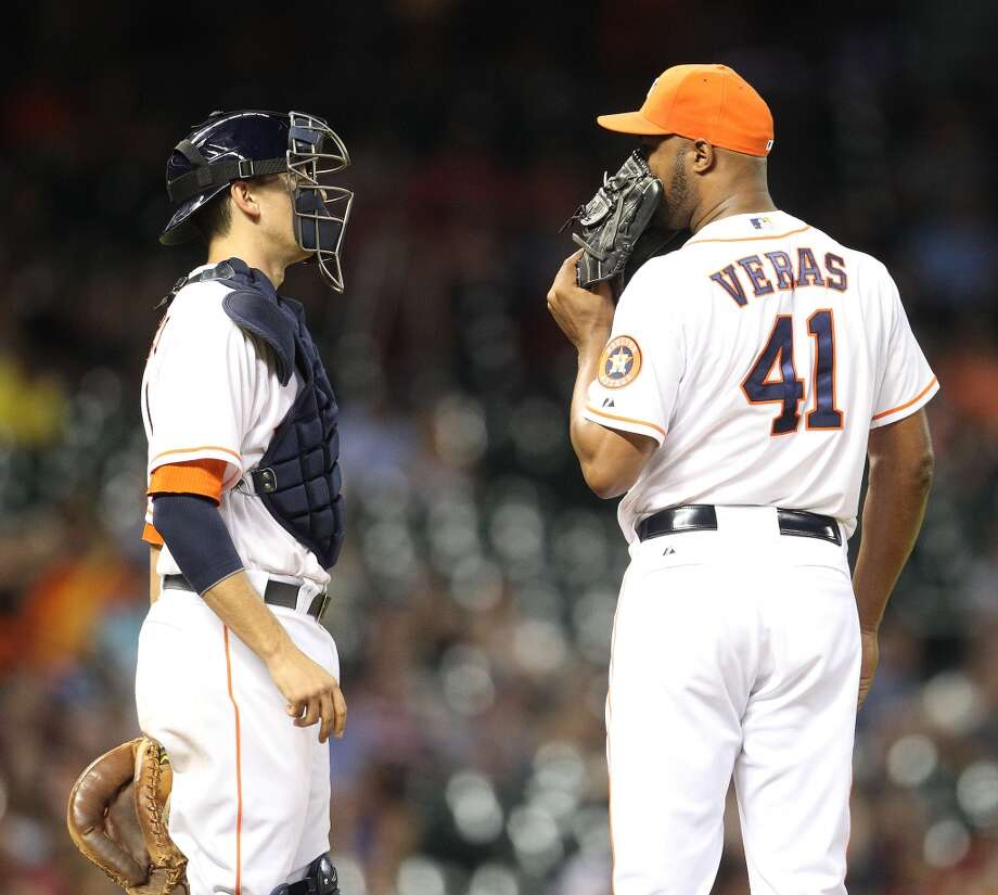 Astros relief pitcher Jose Veras talks with catcher Jason Castro during the ninth inning.