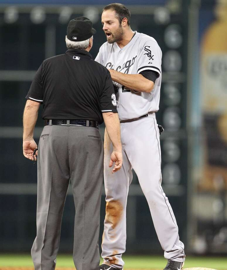 Jordan Danks argues with umpire Dana DeMuth after getting picked off at second.