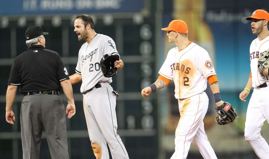 White Sox Jordan Danks argues with umpire Dana DeMuth as the Astros walk off the field.