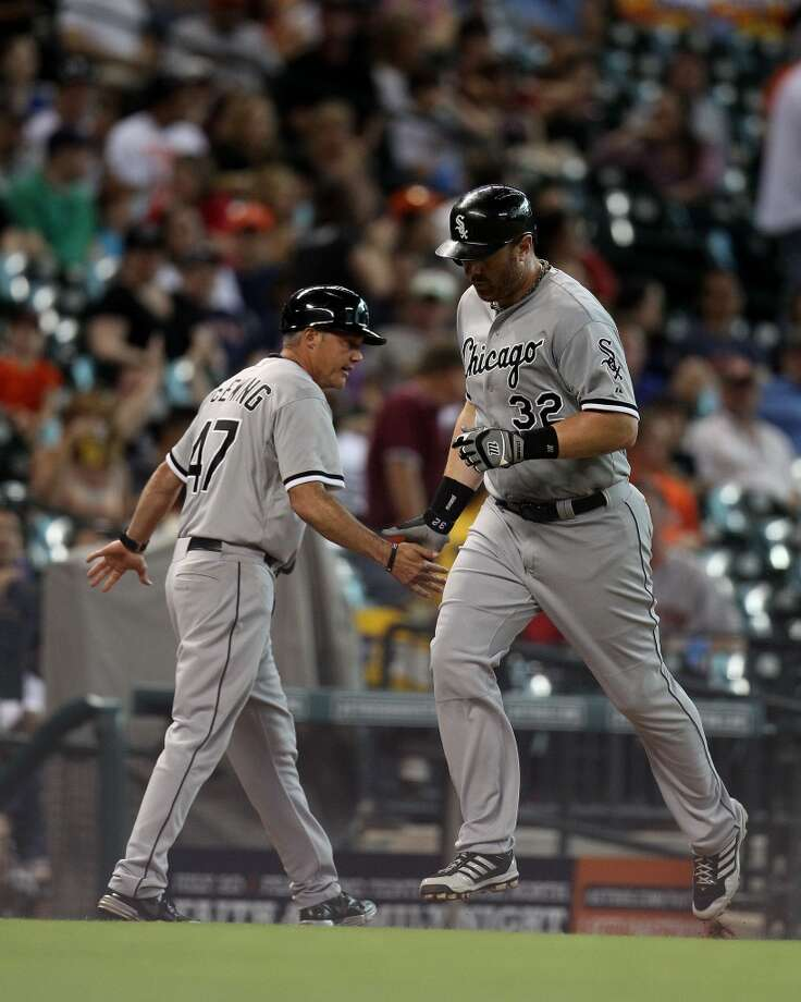 White Sox first baseman Adam Dunn runs past third base coach Joe McEwing after his home run.