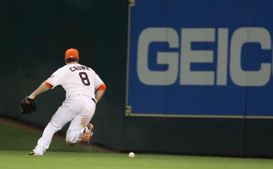 Astros left fielder Trevor Crowe chases a  double hit by White Sox third baseman Conor Gillaspie.