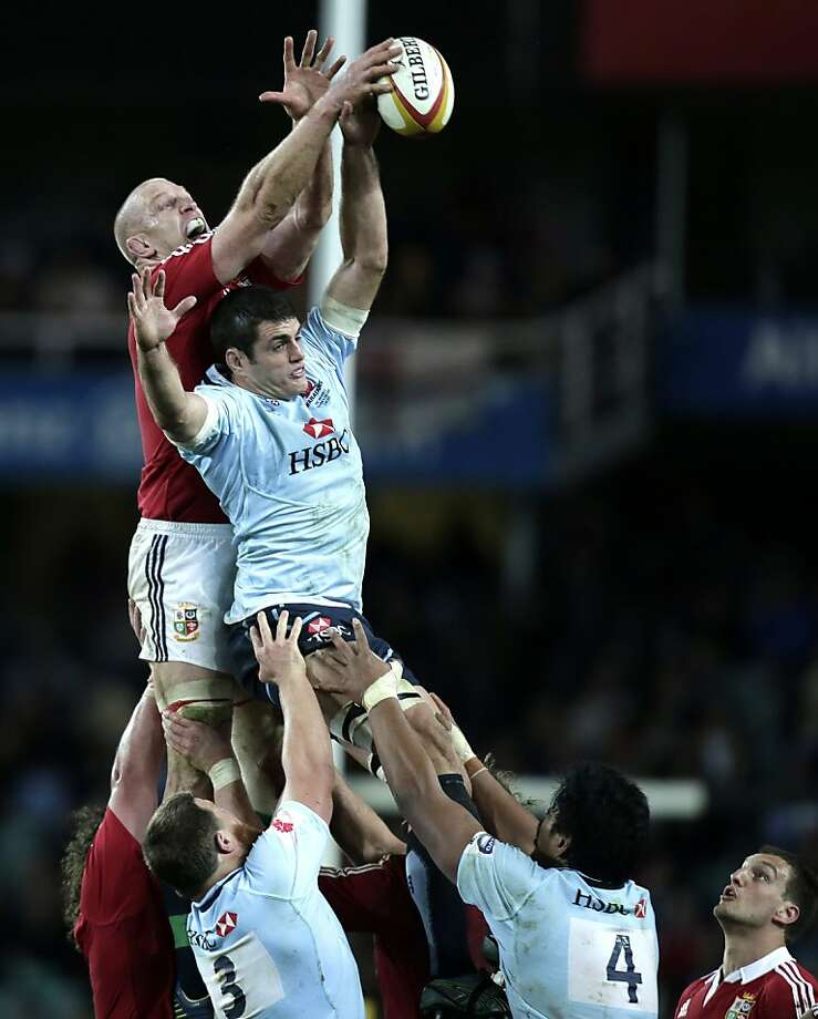 British and Irish Lions' Paul O'Connell, left, and the Waratahs' captain Dave Dennis battle for a line out ball during a rugby union tour match at the Sydney Football Stadium in Sydney, Australia, Saturday, June 15, 2013. The Lions won the match 47-17. (AP Photo/Rick Rycroft) Photo: Rick Rycroft, Associated Press