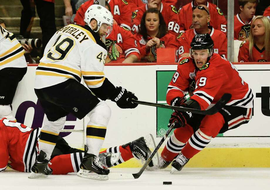 Chicago Blackhawks center Jonathan Toews (19) controls the puck against Boston Bruins center Rich Peverley (49) in the second period during Game 2 of the NHL hockey Stanley Cup Finals, Saturday, June 15, 2013, in Chicago. (AP Photo/Nam Y. Huh) Photo: Nam Y. Huh