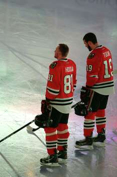 CHICAGO, IL - JUNE 15: Marian Hossa #81 and Jonathan Toews #19 of the Chicago Blackhawks stand before the start of Game Two of the Stanley Cup Final against the Boston Bruins at the United Center on June 15, 2013 in Chicago, Illinois. Photo: Tasos Katopodis, Getty Images / 2013 Getty Images