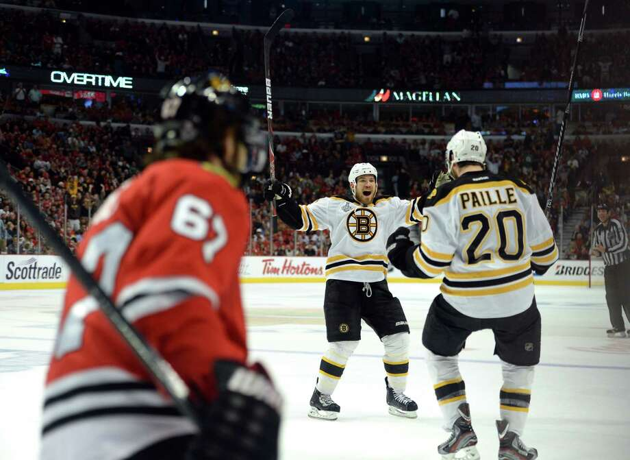 CHICAGO, IL - JUNE 15:  Daniel Paille #20 (R) and Andrew Ference #21 of the Boston Bruins celebrate after Paille scored the game-winning goal in the first overtime against Michael Frolik #67 of the Chicago Blackhawks in Game Two of the NHL 2013 Stanley Cup Final at United Center on June 15, 2013 in Chicago, Illinois. Photo: Harry How, Getty Images / 2013 Getty Images