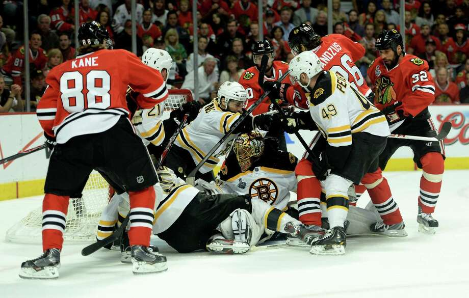 CHICAGO, IL - JUNE 15:  Goalie Tuukka Rask #40 of the Boston Bruins attempts to follow the puck as players from the Bruins and Chicago Blackhawks shove each other in front of the net in Game Two of the NHL 2013 Stanley Cup Final at United Center on June 15, 2013 in Chicago, Illinois. Photo: Harry How, Getty Images / 2013 Getty Images