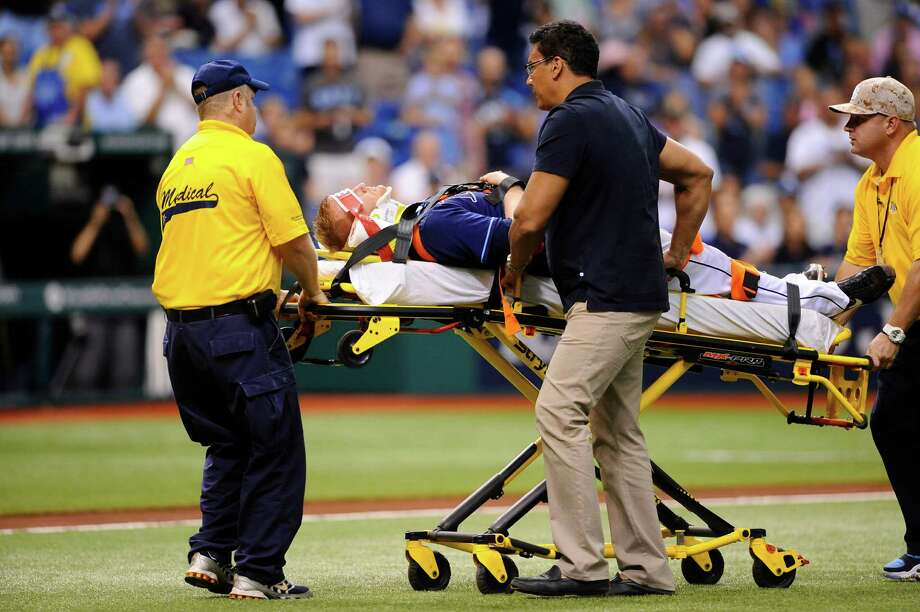 Tampa Bay Rays starting pitcher Alex Cobb lies on a stretcher as he is taken off the field by medical personnel after being hit by a line drive by Kansas City Royals' Eric Hosmer during the fifth inning of a baseball game Saturday, June 15, 2013, in St. Petersburg, Fla. (AP Photo/Brian Blanco) Photo: Brian Blanco