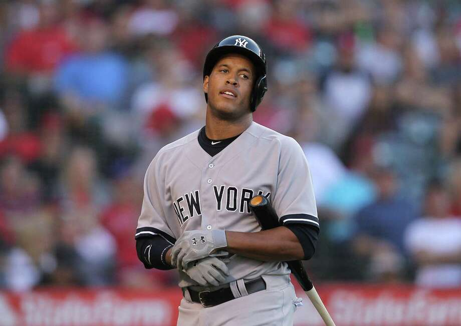 ANAHEIM, CA - JUNE 15:  Thomas Neal #22 of the New York Yankees looks on after striking out in the seventh inning during the MLB game against the Los Angeles Angels of Anaheim at Angel Stadium of Anaheim on June 15, 2013 in Anaheim, California.  (Photo by Victor Decolongon/Getty Images) Photo: Victor Decolongon