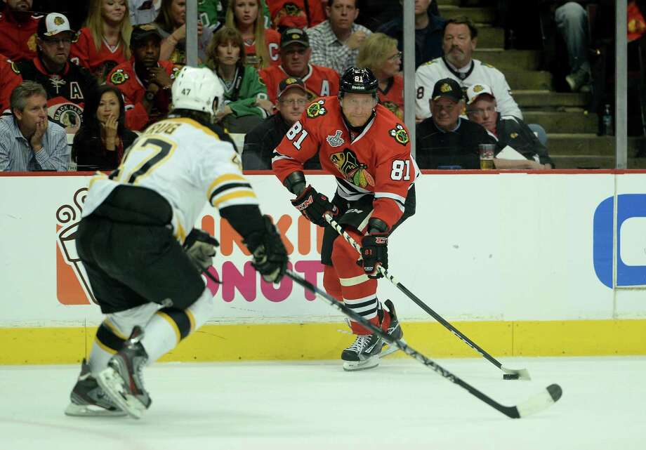 CHICAGO, IL - JUNE 15:  Marian Hossa #81 of the Chicago Blackhawks looks to pass the puck against Torey Krug #47 of the Boston Bruins in Game Two of the NHL 2013 Stanley Cup Final at United Center on June 15, 2013 in Chicago, Illinois. Photo: Harry How, Getty Images / 2013 Getty Images