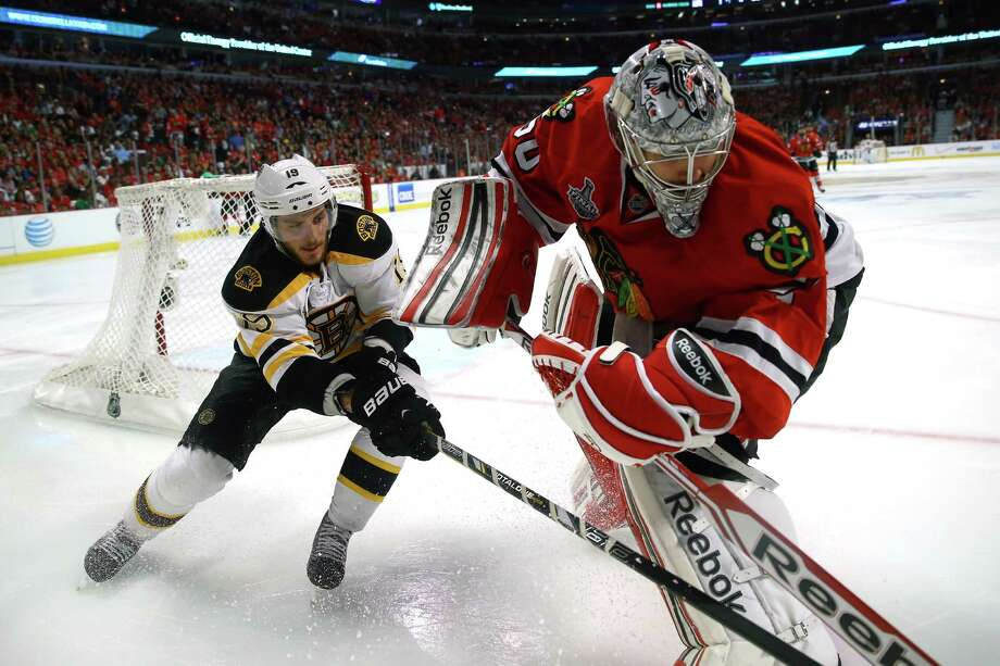CHICAGO, IL - JUNE 15:  Tyler Seguin #19 of the Boston Bruins and goalie Corey Crawford #50 of the Chicago Blackhawks get their sticks tied up in Game Two of the NHL 2013 Stanley Cup Final at United Center on June 15, 2013 in Chicago, Illinois. Photo: Bruce Bennett, Getty Images / 2013 Getty Images