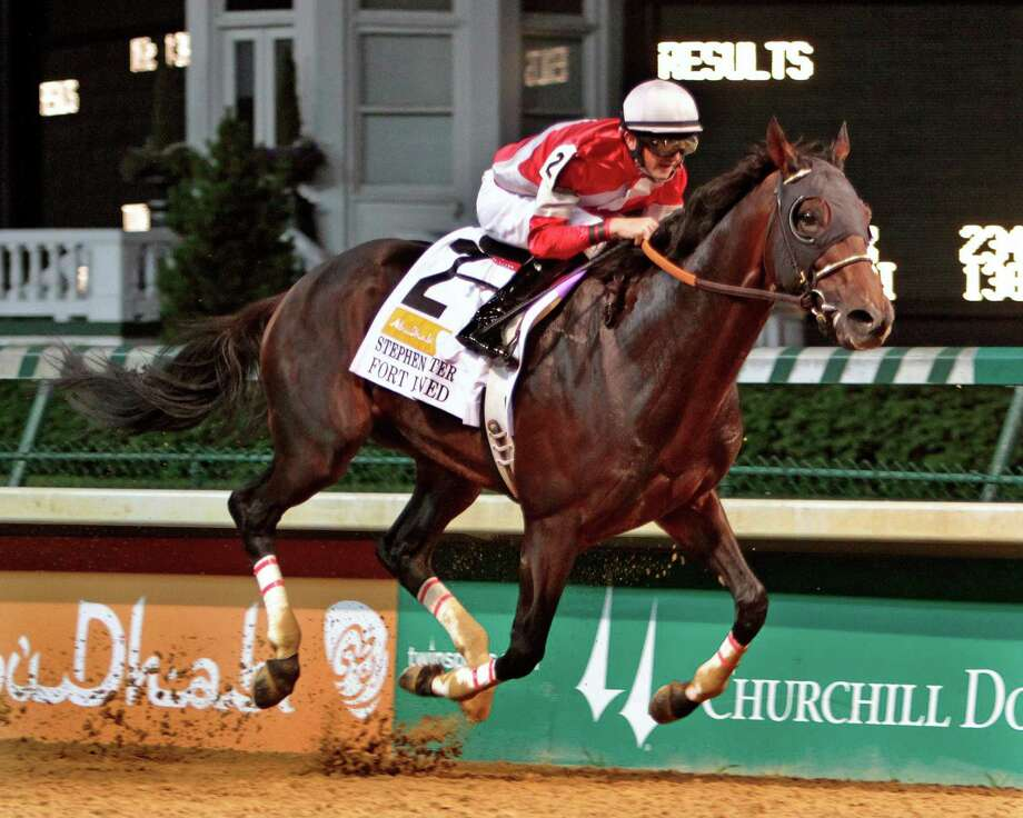 Fort Larned, under jockey Brian Hernandez, rolls to a runaway victory in the Stephen Foster Handicap (Gr. I) horse race at Churchill Downs in Louisville, Ky., Saturday, June 15, 2013.  (AP Photo/Garry Jones) Photo: Garry Jones