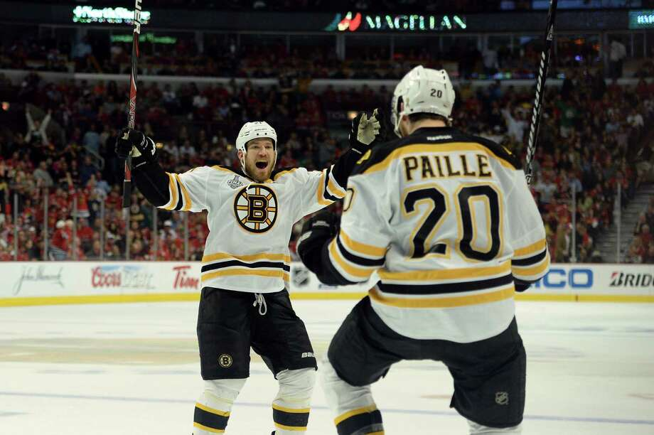 Game 2: Boston 2, Chicago 1 (OT)Best-of-seven series tied 1-1CHICAGO, IL - JUNE 15:  Daniel Paille #20 (R) and Andrew Ference #21 of the Boston Bruins celebrate after Paille scored the game-winning goal in the first overtime against the Boston Bruins in Game Two of the NHL 2013 Stanley Cup Final at United Center on June 15, 2013 in Chicago, Illinois. Photo: Harry How, Getty Images / 2013 Getty Images