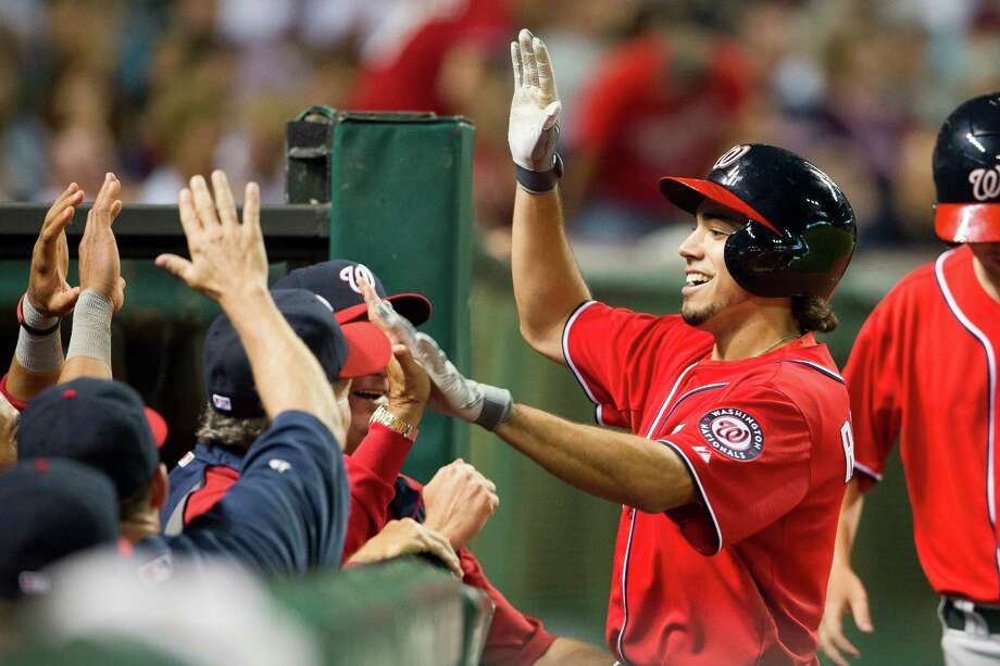 Anthony Rendon, who played at Rice, joins in the fun after his ninth-inning home run - his first in the major leagues - helped Washington win at Cleveland. Photo: Jason Miller, Stringer / 2013 Getty Images