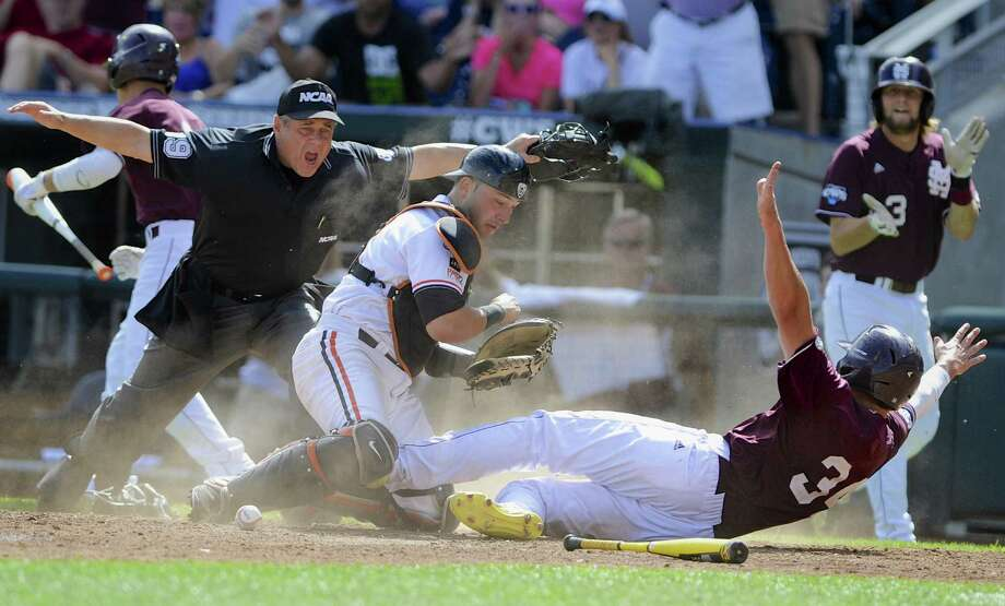 Mississippi State's Hunter Renfroe scores past Oregon State catcher Jake Rodriguez during the eighth inning Saturday in Omaha, Neb. Photo: Eric Francis / Associated Press