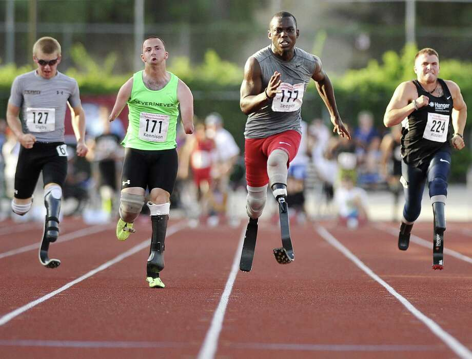 Blake Leeper (177) sprints to victory in the 100-meter dash during the U.S. Paralympic Track and Field Championships at Trinity University. Leeper won with a time of 11.39 seconds. Photo: Darren Abate / For The Express-News