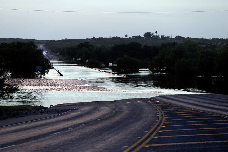 Elm Creek floods over the 277 north bridge preventing traffic from leaving Eagle Pass to Del Rio at Sunset when the water was still rising during cleanup in the aftermath of flooding in Eagle Pass.  on  June 16, 2013. Photo: TOM REEL