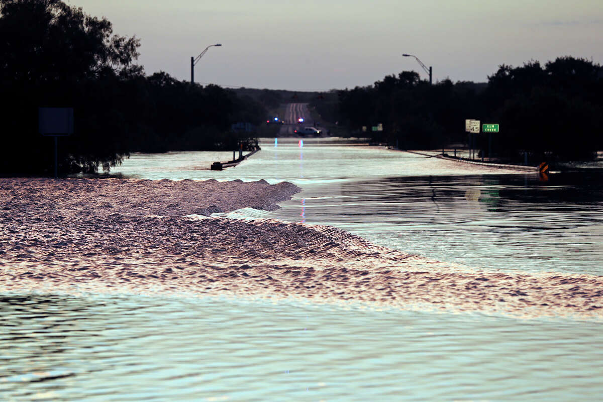 Elm Creek floods over the 277 north bridge preventing traffic from leaving Eagle Pass to Del Rio at Sunset when the water was still rising during cleanup in the aftermath of flooding in Eagle Pass. on June 16, 2013.