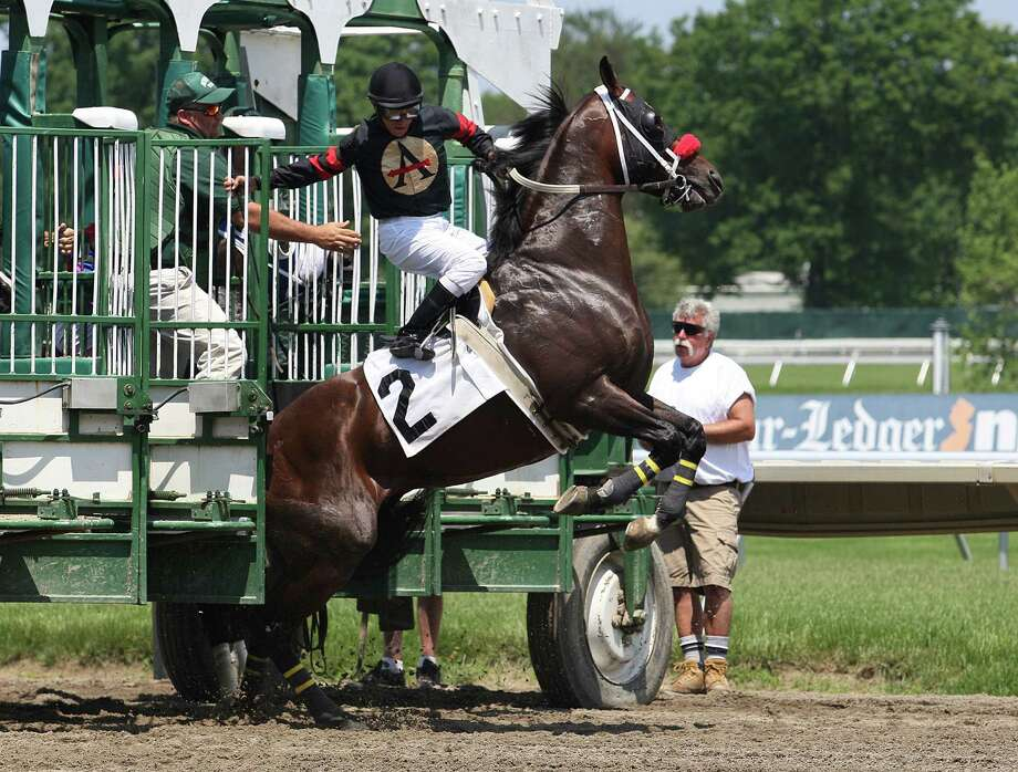 Jockey Elvis Trujillo holds on as Big Kick jumps out of the starting gate Saturday at Monmouth Park in Oceanport, N.J. Trujillo and his mount made it back into the starting gate and finished fourth in the race. Photo: Bill Denver, HOEP / EQUI-PHOTO