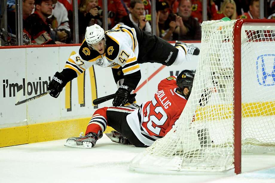 CHICAGO, IL - JUNE 15:  Torey Krug #47 of the Boston Bruins falls to the ice over Brandon Bollig #52 of the Chicago Blackhawks in Game Two of the NHL 2013 Stanley Cup Final at United Center on June 15, 2013 in Chicago, Illinois.  (Photo by Harry How/Getty Images) Photo: Harry How, Getty Images