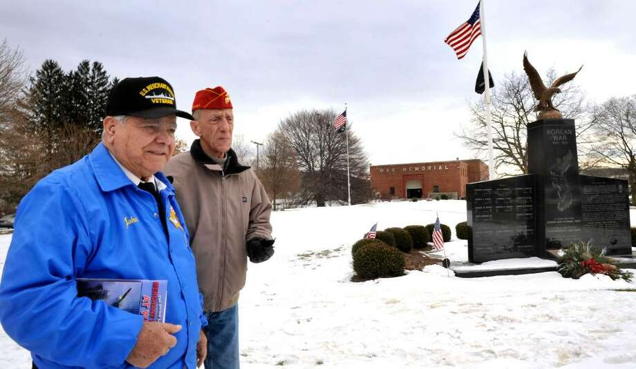 John Scalzo, 83, a former Merchant Marine, left, who is leading the effort for a monument in Danbury, and John Hill, 64, treasurer of the Merchant Marine Memorial committee, at the proposed site of the monument, in Rodger's Park, in Danbury, on Wendesday, Jan. 13,2010. Photo: Michael Duffy / The News-Times