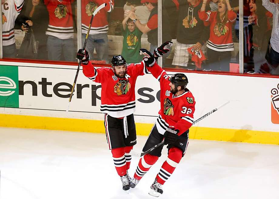 CHICAGO, IL - JUNE 15:  Patrick Sharp #10 of the Chicago Blackhawks celebrates with teammate Michal Rozsival #32 after scoring a goal in the first period against Tuukka Rask #40 of the Boston Bruins in Game Two of the NHL 2013 Stanley Cup Final at United Center on June 15, 2013 in Chicago, Illinois.  (Photo by Gregory Shamus/Getty Images) Photo: Gregory Shamus, Getty Images
