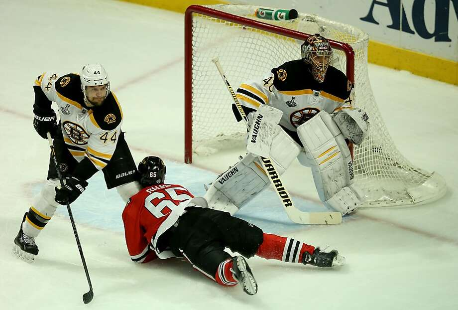 CHICAGO, IL - JUNE 15:  Tuukka Rask #40 of the Boston Bruins tends goal as Andrew Shaw #65 of the Chicago Blackhawks falls to the ice in Game Two of the NHL 2013 Stanley Cup Final at United Center on June 15, 2013 in Chicago, Illinois.  (Photo by Jonathan Daniel/Getty Images) Photo: Jonathan Daniel, Getty Images