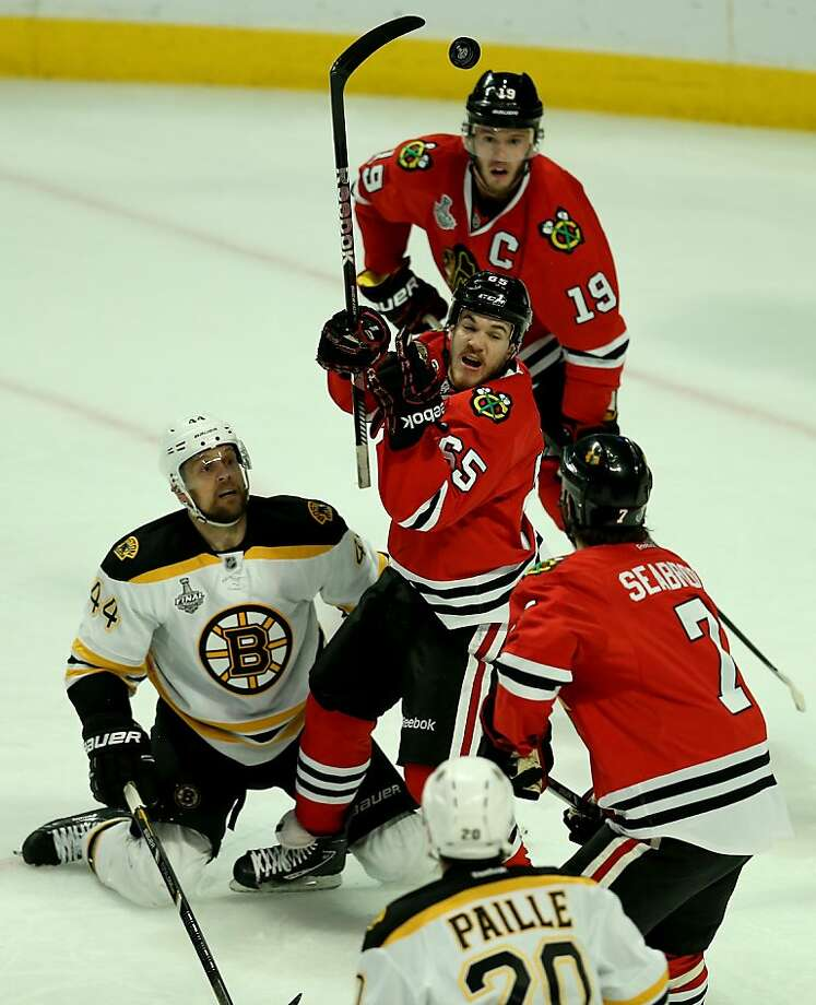 CHICAGO, IL - JUNE 15:  Andrew Shaw #65 of the Chicago Blackhawks falls to the ice against the Boston Bruins in Game Two of the NHL 2013 Stanley Cup Final at United Center on June 15, 2013 in Chicago, Illinois.  (Photo by Jonathan Daniel/Getty Images) Photo: Jonathan Daniel, Getty Images