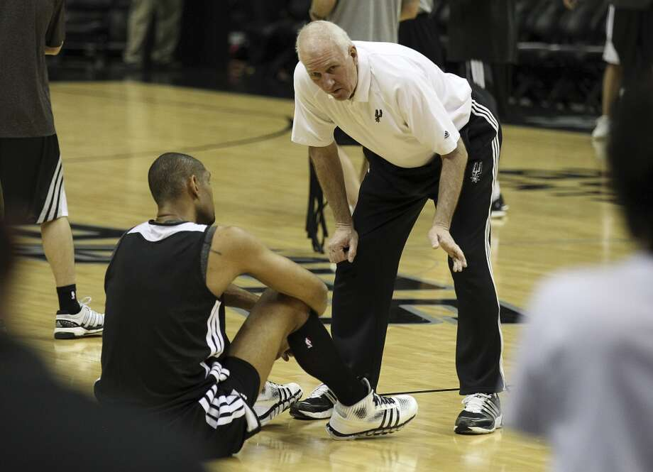 San Antonio Spurs head coach Gregg Popovich (right) talks with Tim Duncan during practice and media sessions at the at the AT&T Center on Saturday, June 15, 2013. (Kin Man Hui / San Antonio Express-News)