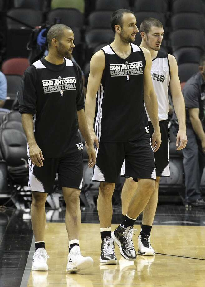 San Antonio Spurs' Tony Parker, Manu Ginobili and Nando De Colo walk up court during practice and media sessions at the at the AT&T Center on Saturday, June 15, 2013. (Kin Man Hui / San Antonio Express-News)