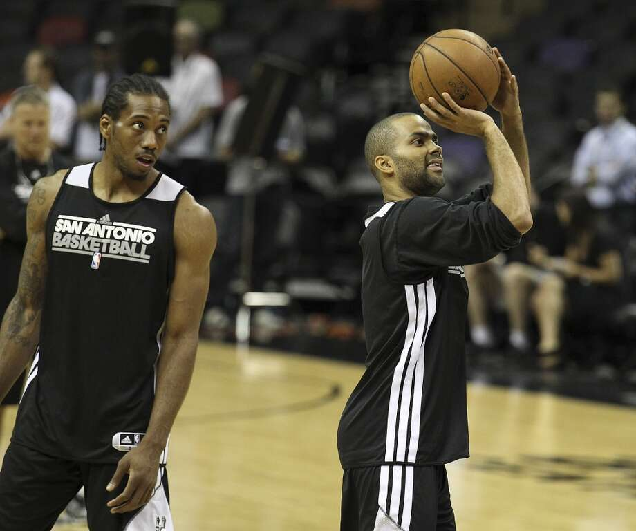 San Antonio Spurs' Tony Parker takes a shot as Kawhi Leonard watches during practice and media sessions at the at the AT&T Center on Saturday, June 15, 2013. (Kin Man Hui / San Antonio Express-News)