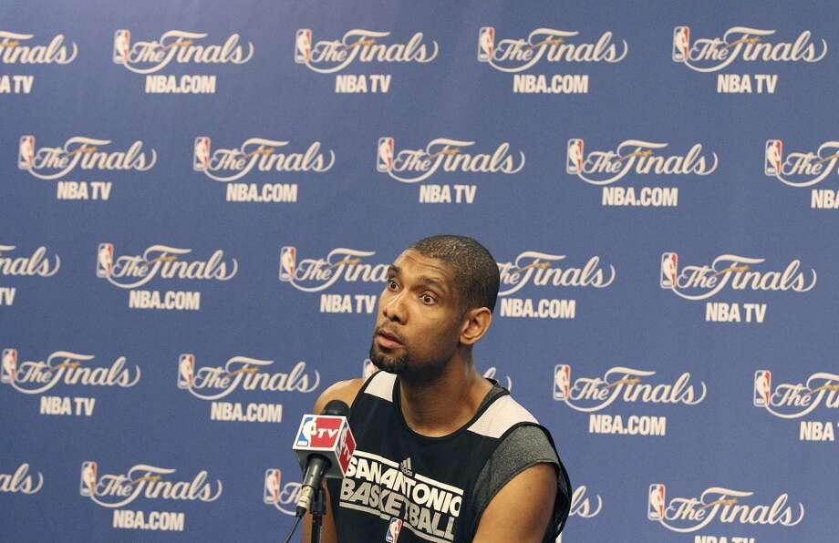 San Antonio Spurs' Tim Duncan takes questions during practice and media sessions at the at the AT&T Center on Saturday, June 15, 2013. (Kin Man Hui / San Antonio Express-News)