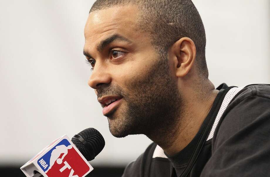 San Antonio Spurs' Tony Parker takes questions during practice and media sessions at the at the AT&T Center on Saturday, June 15, 2013. (Kin Man Hui / San Antonio Express-News)
