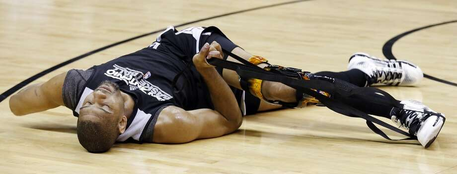 San Antonio Spurs' Tim Duncan stretches during practice Saturday June 15, 2013 at the AT&T Center. (Edward A. Ornelas / San Antonio Express-News)
