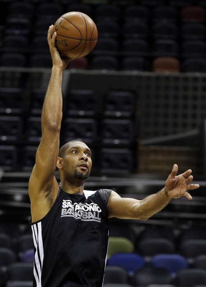 San Antonio Spurs' Tim Duncan shoots during practice Saturday June 15, 2013 at the AT&T Center. (Edward A. Ornelas / San Antonio Express-News)