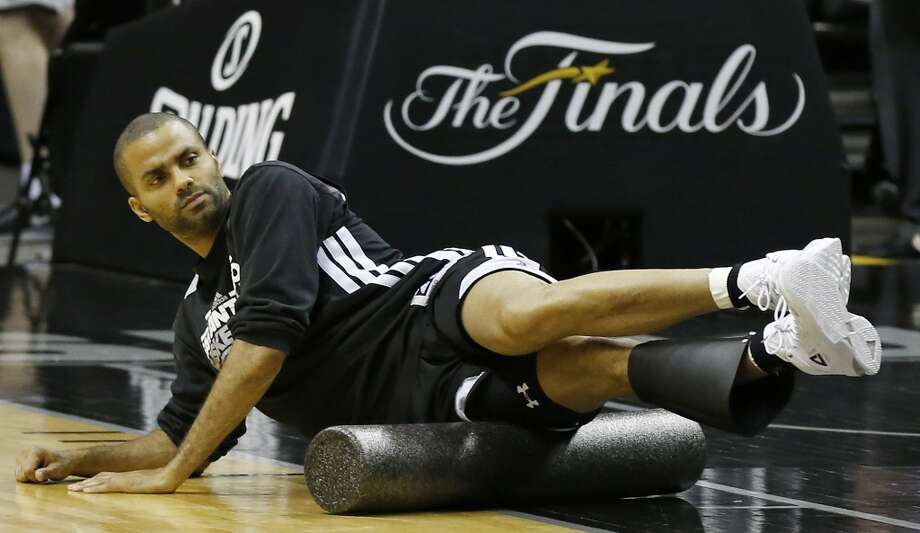 San Antonio Spurs' Tony Parker uses a foam roller during practice Saturday June 15, 2013 at the AT&T Center. (Edward A. Ornelas / San Antonio Express-News)