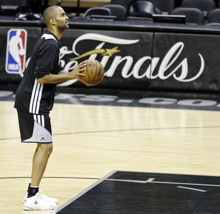 San Antonio Spurs' Tony Parker shoots during practice Saturday June 15, 2013 at the AT&T Center. (Edward A. Ornelas / San Antonio Express-News)
