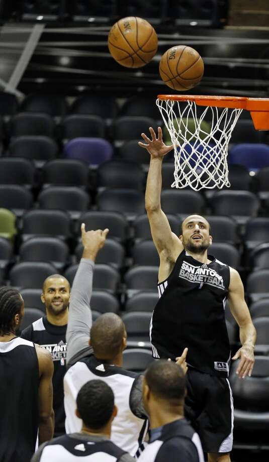 San Antonio Spurs' Manu Ginobili and teammates drill during practice Saturday June 15, 2013 at the AT&T Center. (Edward A. Ornelas / San Antonio Express-News)