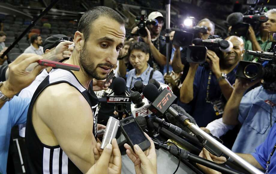 San Antonio Spurs' Manu Ginobili answers questions from the media during practice Saturday June 15, 2013 at the AT&T Center. (Edward A. Ornelas / San Antonio Express-News)