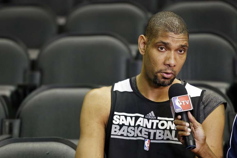San Antonio Spurs' Tim Duncan answers questions from the media during practice Saturday June 15, 2013 at the AT&T Center. (Edward A. Ornelas / San Antonio Express-News)