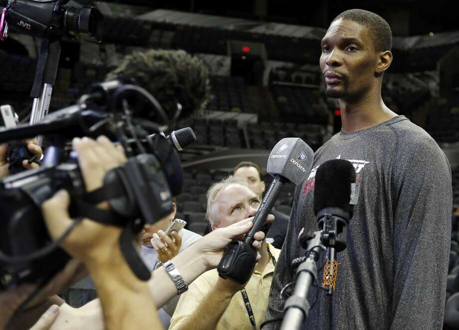 Miami Heat's Chris Bosh answers questions from the media during practice Saturday June 15, 2013 at the AT&T Center. (Edward A. Ornelas / San Antonio Express-News)