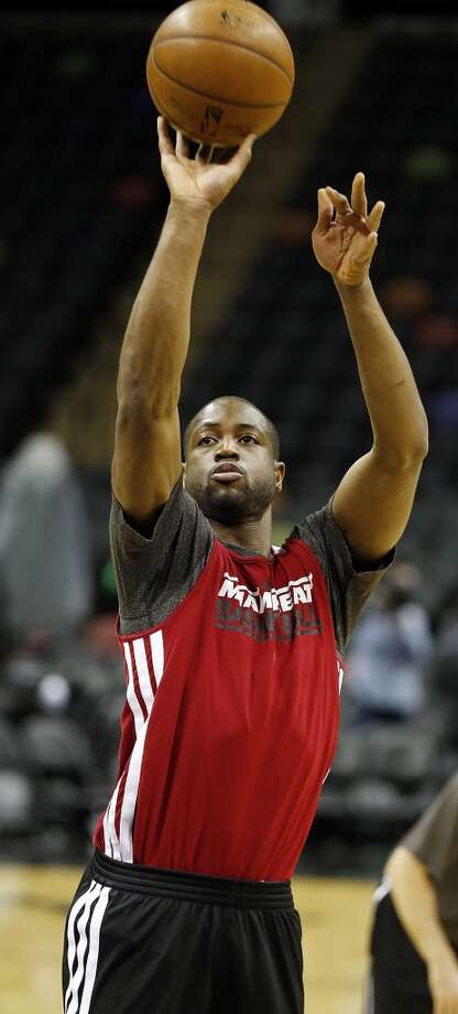 Miami Heat's Dwyane Wade shoots during practice Saturday June 15, 2013 at the AT&T Center. (Edward A. Ornelas / San Antonio Express-News)