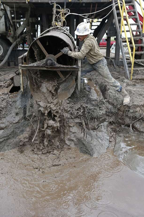 After reaching total depth, derrick man Anatolio Salinas, 30, of Alice, Texas, helps out as they clean the drill site at the Holdsworth No. 8 well on the Tortuga Ranch in Zavala County, Monday, April 8, 2013. Photo: Jerry Lara, San Antonio Express-News