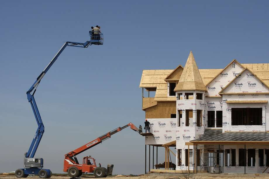 """A family uses a lift to view their """"big house"""" under construction at the Tortuga Ranch in Zavala County, in this file photo from Monday, April 8, 2013. Photo: Jerry Lara, San Antonio Express-News"""