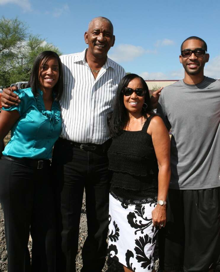 Father poses with his son, daughter Tia Gervin and wife Joyce Gervin at the ground breaking for the George Gervin Youth Center in 2009.