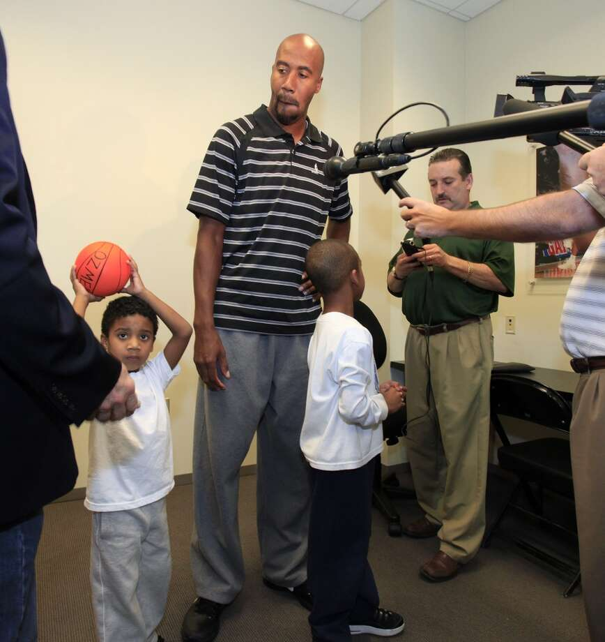 Former Spur Bruce Bowen is joined by his sons, Ozmel (left) and Ojani prior to speaking to the media regarding the Spurs' announcement that the organization will retire his jersey on Jan. 26, 2012, at the Spurs practice facility.