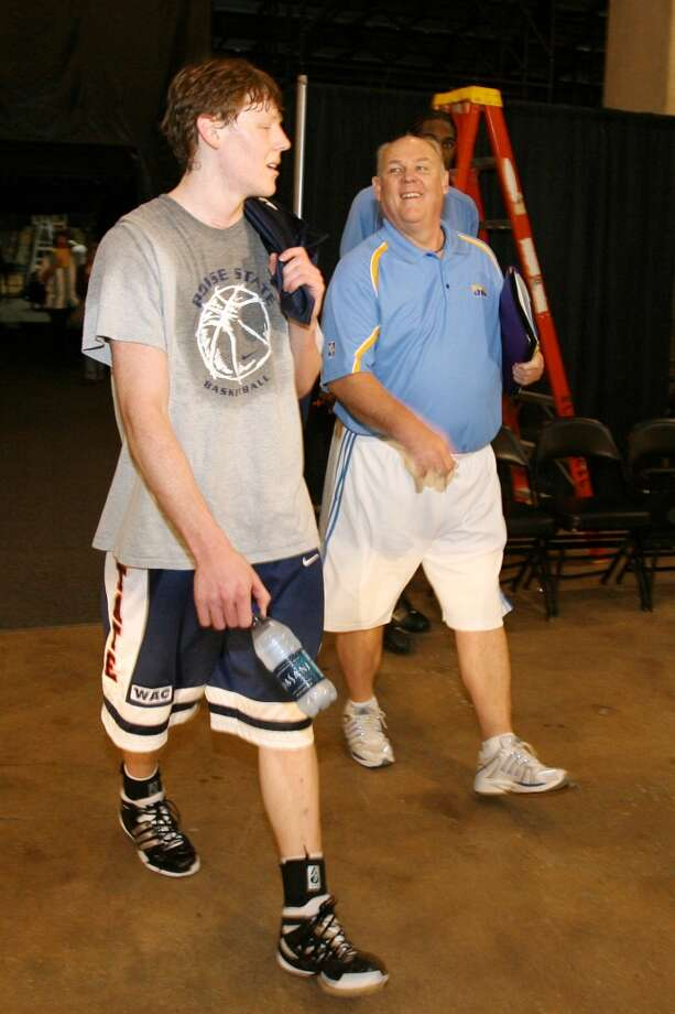 Son and father walk together after the Denver Nuggets' practice between Games 1 and 2 of the Western Conference quarterfinals against the San Antonio Spurs during the 2007 NBA Playoffs at AT&T Center on April 23, 2007.