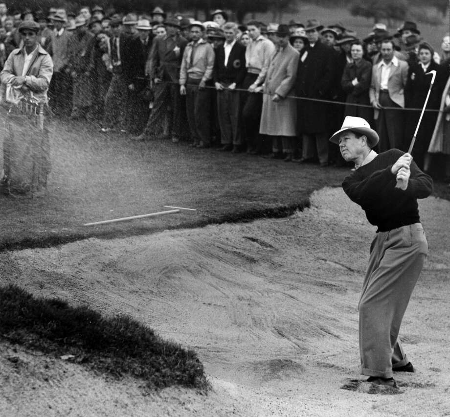 Byron Nelson blasts out of a sand trap on the 18th hole of the third round of the Oakland Open held at at the Sequoyah Country Club in Oakland, Calif. on January 8, 1942.